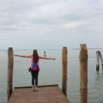 Standing on a pier in Murano.