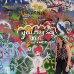 """You may say I'm a dreamer..."" The Lennon Wall in Prague with it's cool Beatles graffiti."