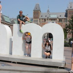Chilling on the 'm' of Amsterdam, one of our last stops. Love that we got a pic of all of us!